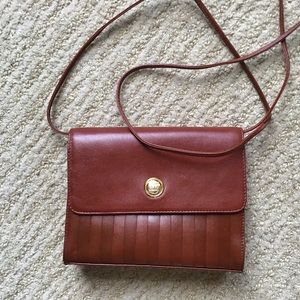 Cute small brown leather crossbody.